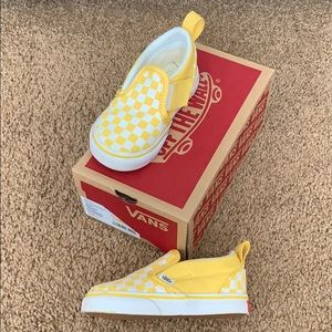 Yellow checkerboard slip on vans